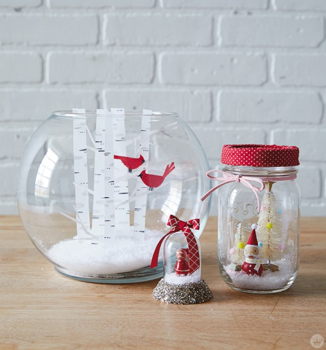 DIY winter snow globe scenes in a red and white color palette