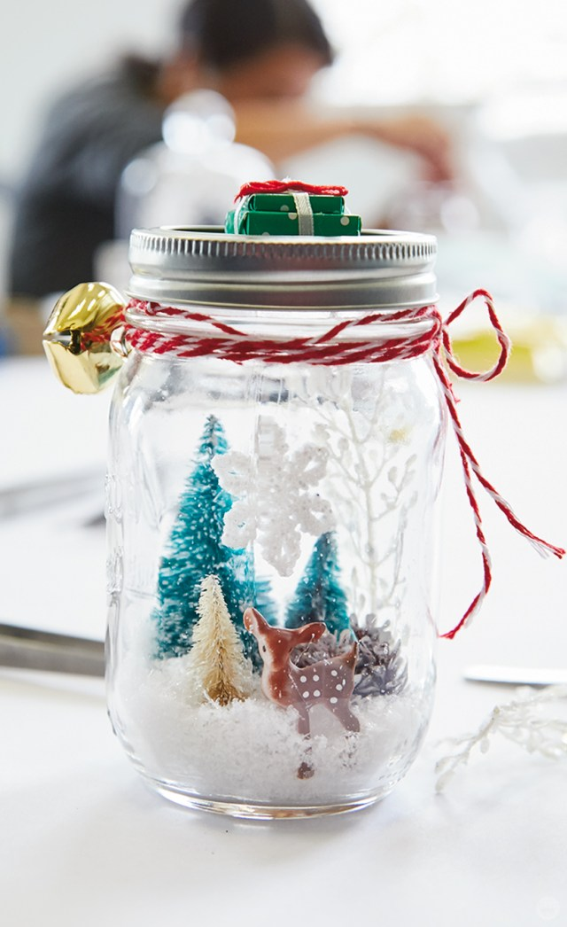 Decorations inside and outside a mason jar snow globe