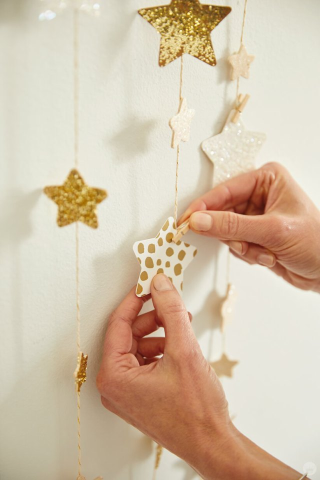 attaching a star to the DIY Star Wall Hanging with a mini clothespin | thinkmakeshareblog.com