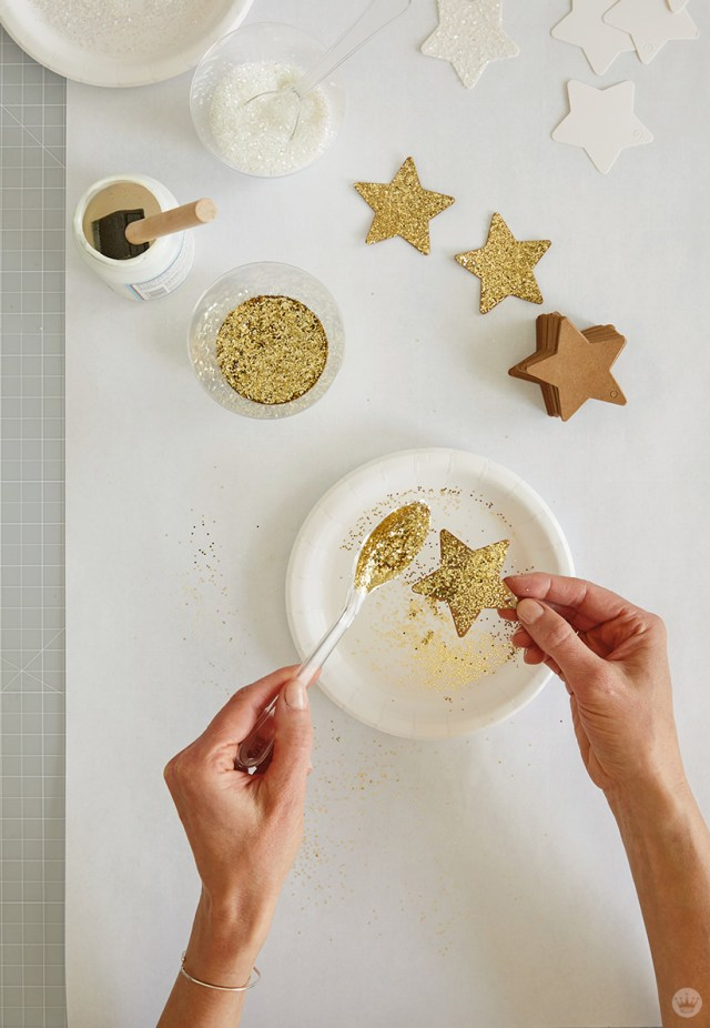 glittering a star for the DIY Star Wall Hanging | thinkmakeshareblog.com