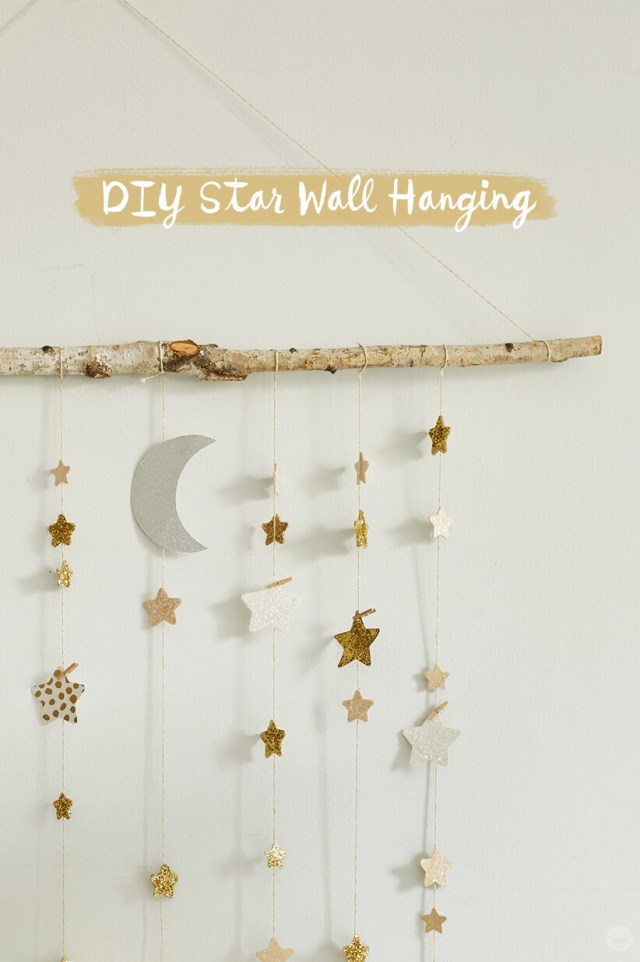 DIY Star Wall Hanging: glittery paper stars hanging on twine from a tree branch | thinkmakeshareblog.com