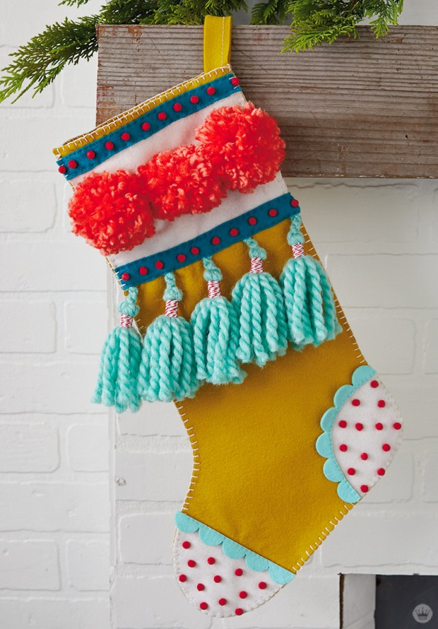 DIY Christmas stocking with pom poms and tassels