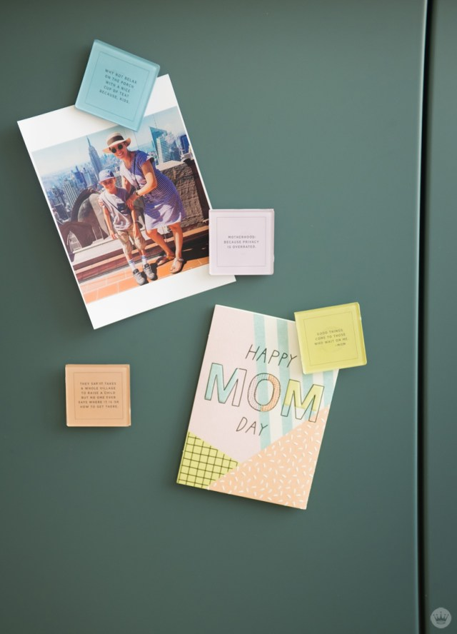 Magnets holding a photo and greeting card.