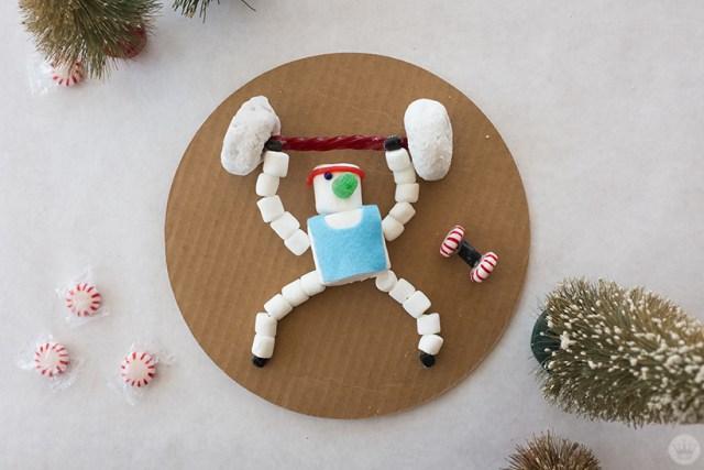 Marshmallow snowman weightlifter