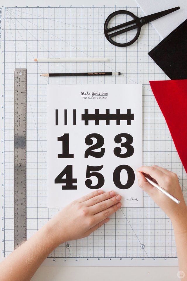 Cutting out numbers for a DIY Felt Pennant Banner