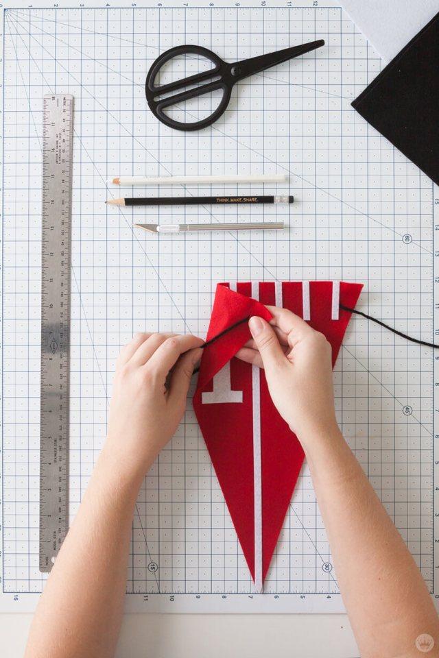Cutting slits in a DIY Felt Pennant Banner