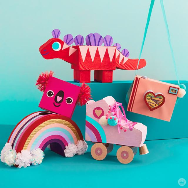 Kids' valentine box ideas: Dinosaur, camera, roller skate, rainbow and koala made out of craft supplies | thinkmakeshareblog.com