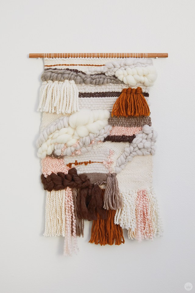 Weaving workshop: finished piece of fiber art with tight palette and organic lines