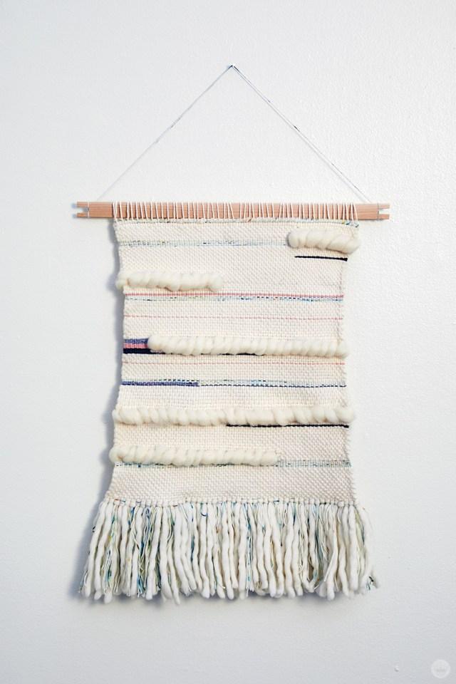 Weaving workshop: large finished fiber art piece in monochromatic color palette