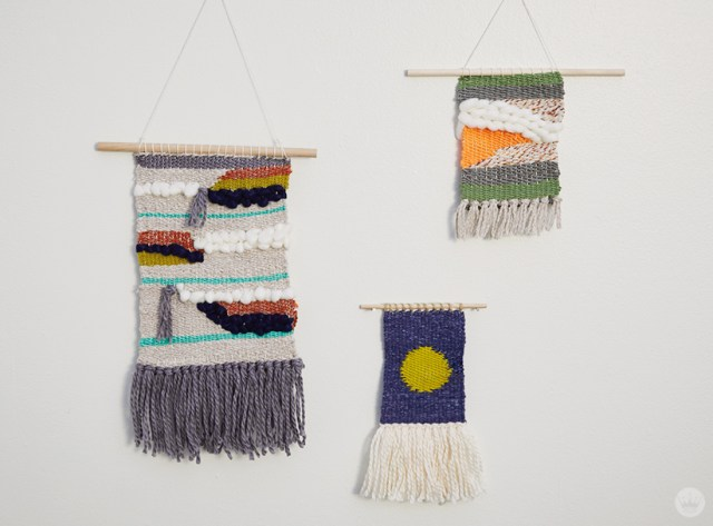 Weaving workshop: finished fiber art pieces in bright color palettes with tassels and roving