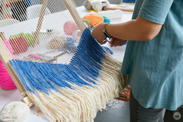 Weaving workshop: hallmark artist creates fiber art piece on large loom