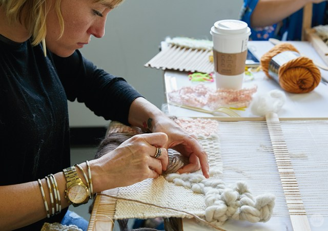 Weaving workshop: hallmark artist weaves monochromatic fiber art piece on large loom