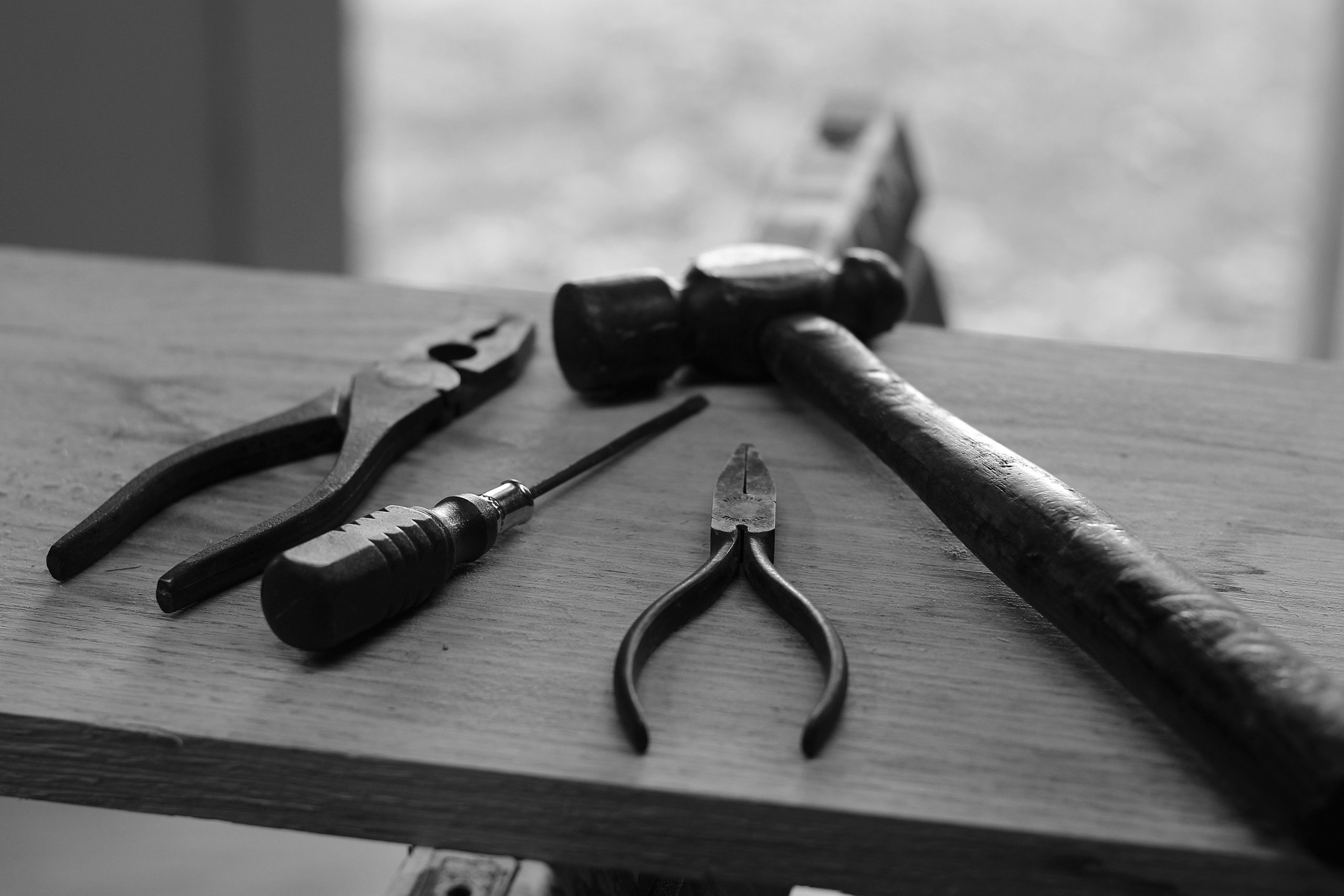 Black and white picture of tools on a bench