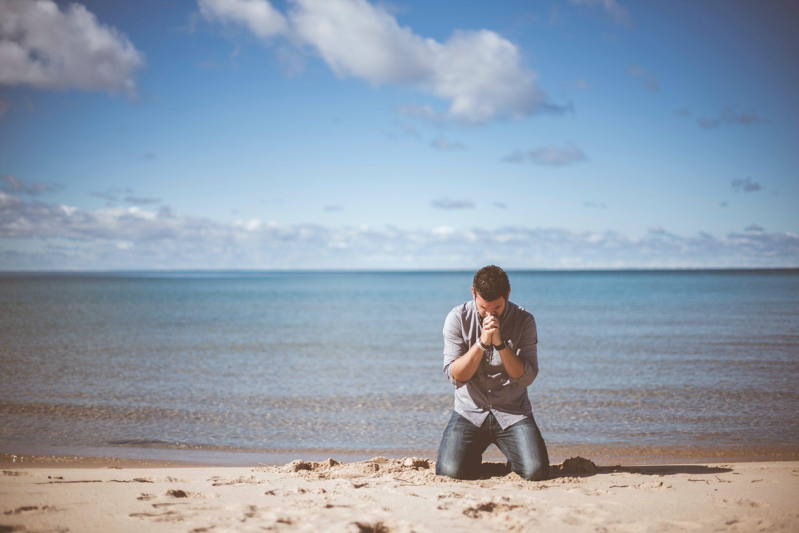 Man begging on the beach