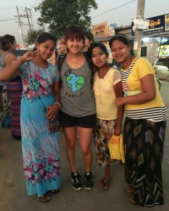 An image of me with Khin, Nae Nae, and another friend at the Dala ferry terminal at the end of the day.