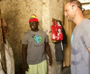 Image of RAKLife founder, Matt Foster, speaking with an elder in Paje Village, Zanzibar.