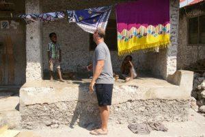 Image of Matt Foster, founder of RAKLife, talking with children as we walked through Paje Village, Zanzibar.