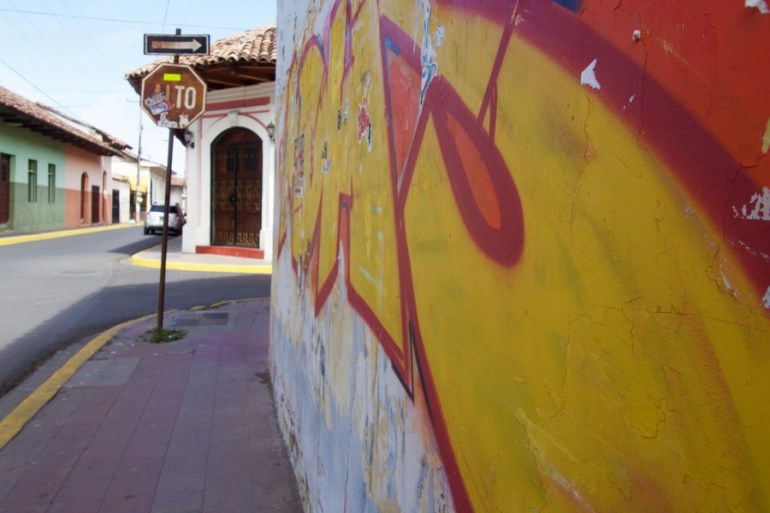 Image of brightly colored street art on side of building in Granada, Nicaragua.