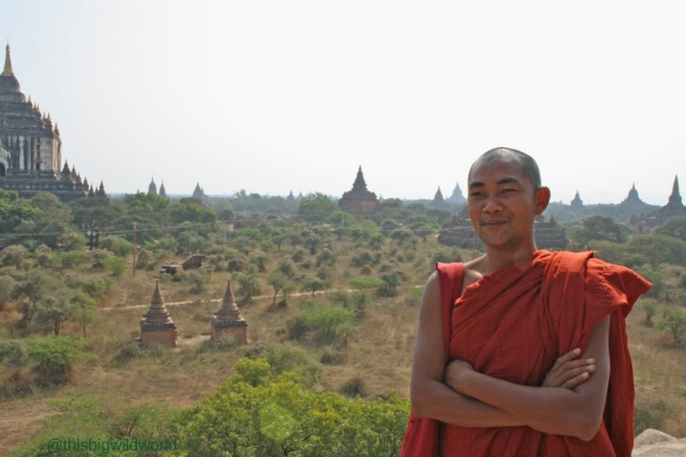 Image of a monk at the top of a temple in Bagan Myanmar.