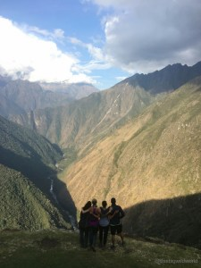 Image of my squad looking out at the Andes Mountains at the end of Day 3 of the Inca Trail hike.