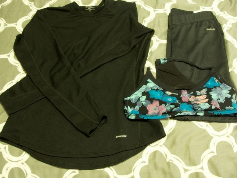 Image of pajamas packed for hiking the Inca Trail in Peru, including long sleeve base layer, sports bra, and base layer pants.