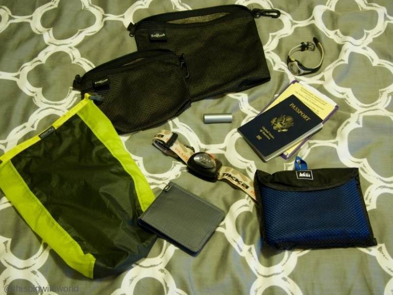 Image of essential items to pack for the Inca Trail hike in Peru, including headlamp, passport, wallet and other items.