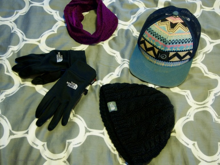 Image of outerwear to pack for the Inca Trail hike in Peru, including wool hat, scarf and gloves.