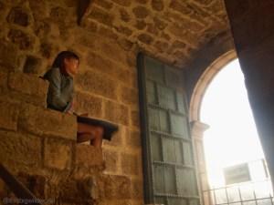 Image of me looking out onto Plaza de Armas from Templo de la Compania de Jesus en Cusco.