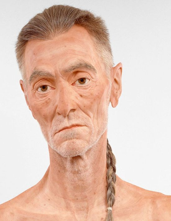 man with long hair sculpture
