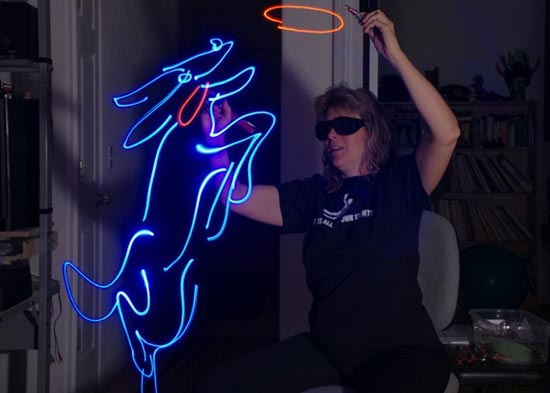 light-paiting-woman-and-dog