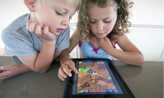 Children playing computer game on an iPad