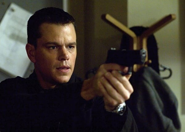 6 iconic Matt Damon roles - Jason Bourne, portrayed here holding a gun.