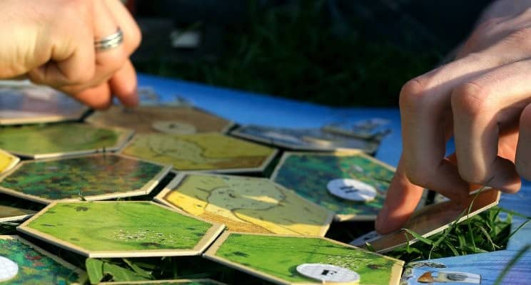 closeup on people playing board games