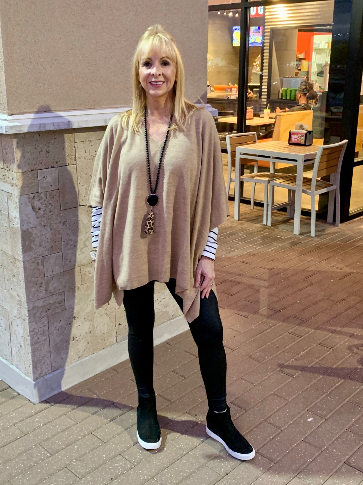 Poncho + Faux Leather Leggings + Wedge Sneakers