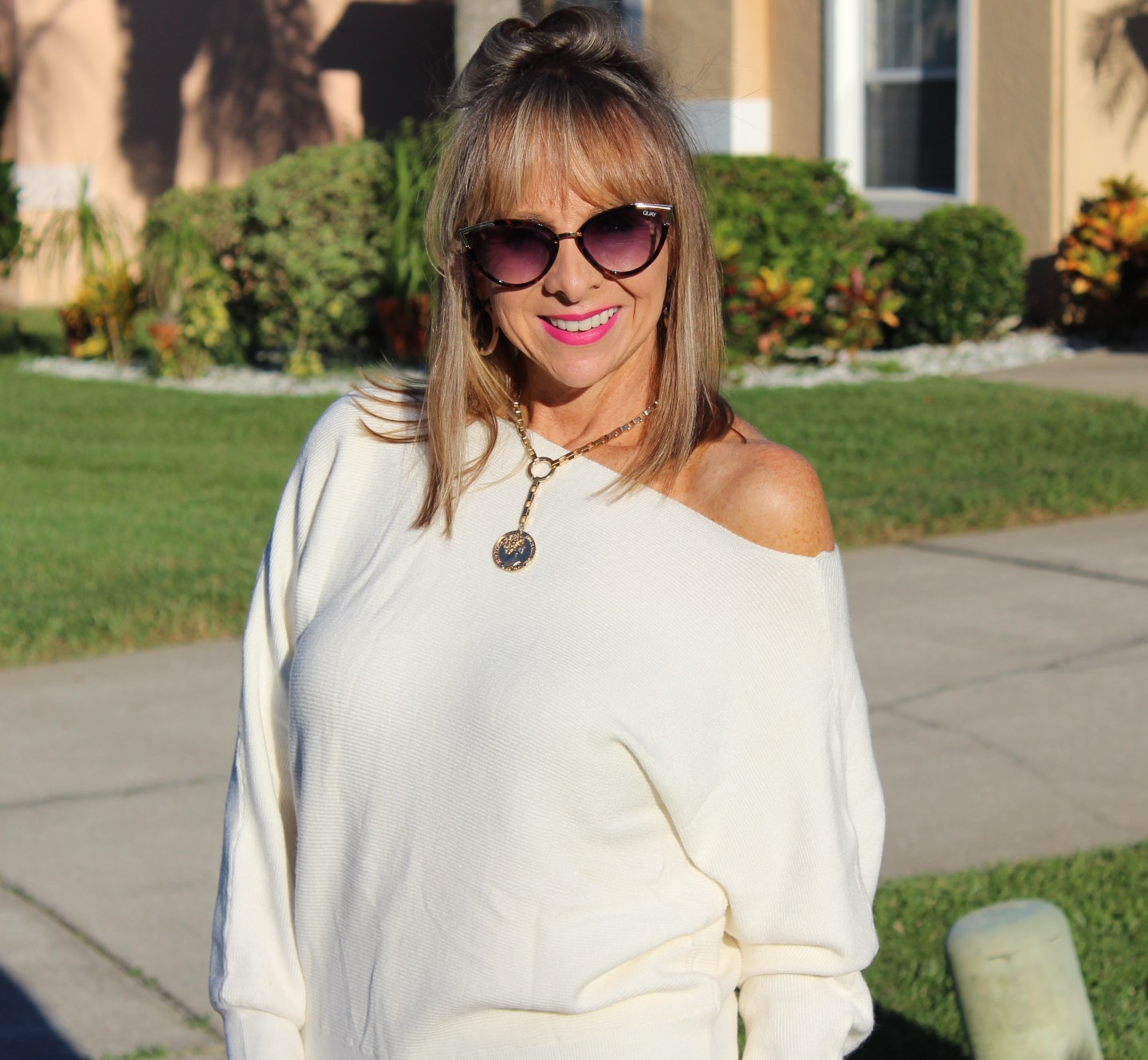 Off the shoulder cream sweater