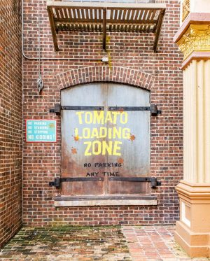 """A wall reading """"Tomato Loading Zone"""" with tomato stains at Disney's Hollywood Studios."""