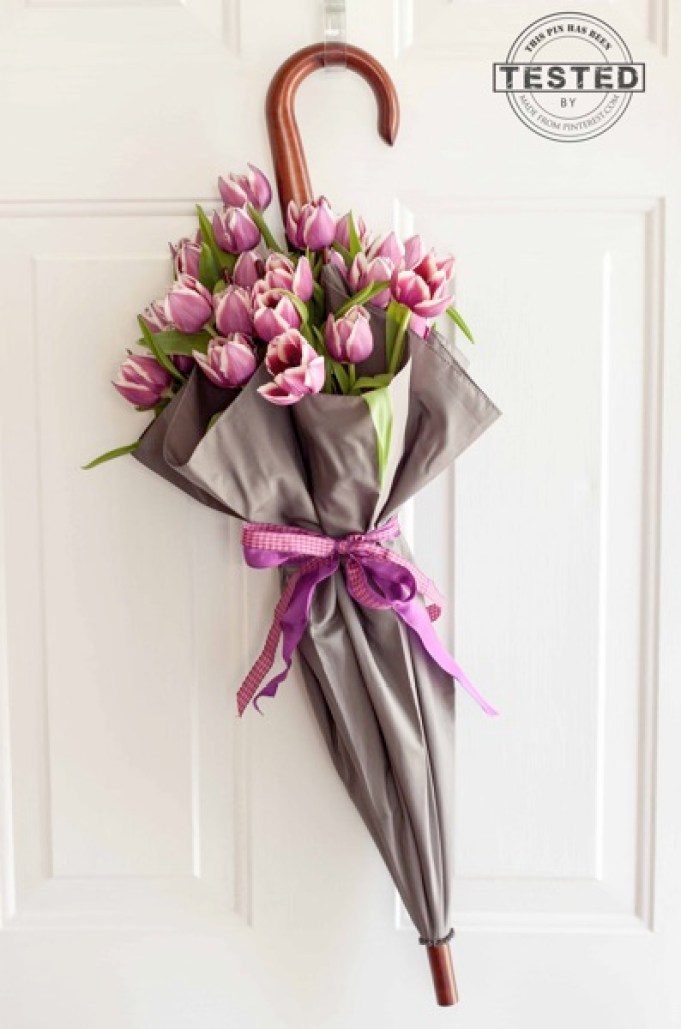 Celebrate spring with this stunning fresh floral arrangement on your front door. One little trick will keep your flowers fresh for a week or two! This is such a creative take on a wreath that has a little bit of whimsy.