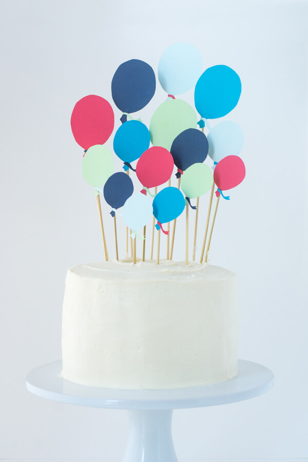 A First Birthday Cake With Paper Balloons