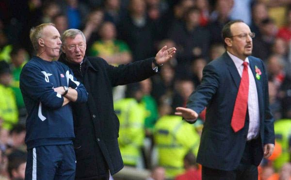 LIVERPOOL, ENGLAND - Sunday, October 25, 2009: Liverpool's manager Rafael Benitez organises his team, while Manchester United's manager Alex Ferguson tries to influence the fourth official, a tactic he uses when losing, during the Premiership match at Anfield. (Photo by David Rawcliffe/Propaganda)