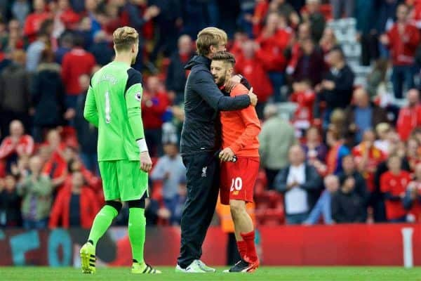 LIVERPOOL, ENGLAND - Saturday, September 24, 2016: Liverpool's manager Jürgen Klopp hugs goalscorer Adam Lallana after the 5-1 victory over Hull City during the FA Premier League match at Anfield. (Pic by David Rawcliffe/Propaganda)
