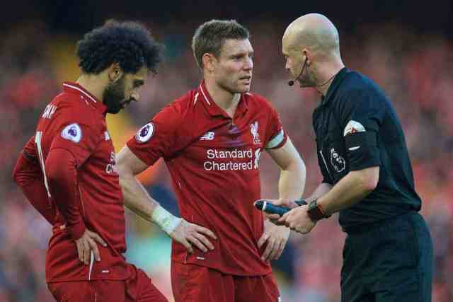 LIVERPOOL, ENGLAND - Saturday, February 9, 2019: Liverpool's Mohamed Salah (L) and captain James Milner (C) are spoken to by referee Anthony Taylor during the FA Premier League match between Liverpool FC and AFC Bournemouth at Anfield. (Pic by David Rawcliffe/Propaganda)