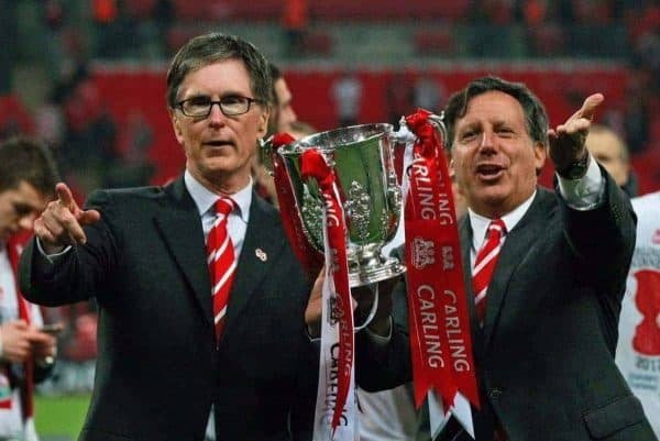 Liverpool's chairman Tom Werner, right, and owner John W. Henry, left, celebrate with the trophy after their team defeated Cardiff City, winning the English League Cup at the final soccer match at Wembley Stadium, in London, Sunday, Feb. 26, 2012. (AP Photo/Tim Hales)
