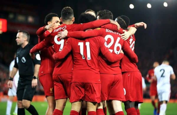 Liverpool's Mohamed Salah (centre) celebrates scoring his side's first goal of the game with team-mates during the Premier League match at Anfield, Liverpool.