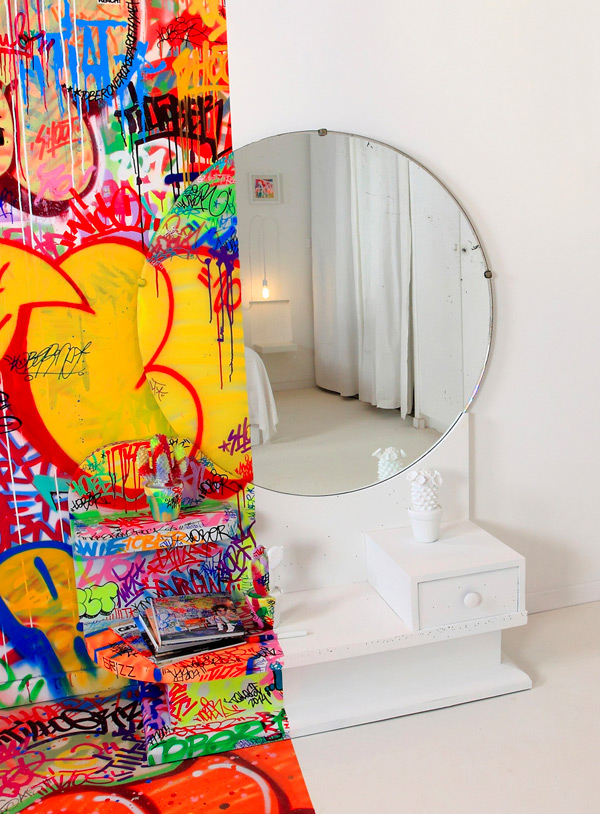 A French Hotel Room Half Covered in Graffiti interior design graffiti France art