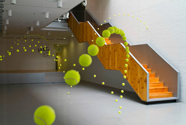2,000 Suspended Tennis Balls Appear to Bounce Through Mustang Art Gallery tennis installation art
