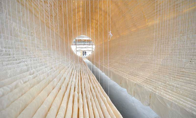 A Suspended Boat of 8,000 Sheets of Rice Paper Draped on Bamboo by Zhu Jinshi sculpture paper multiples installation boats bamboo