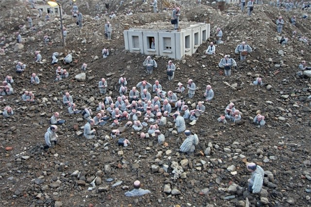 Follow the Leaders: A Corporate City in Ruins by Isaac Cordal street art sculpture installation cement