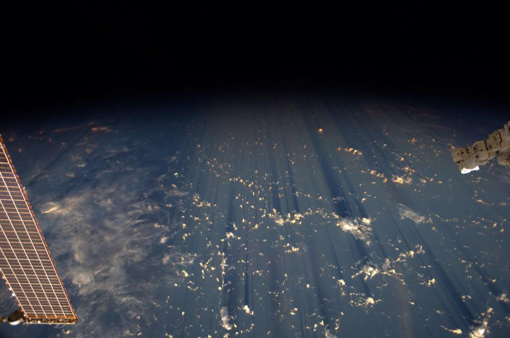 Clouds Cast Thousand Mile Shadows into Space When Viewed Aboard the International Space Station space shadows ISS Earth clouds