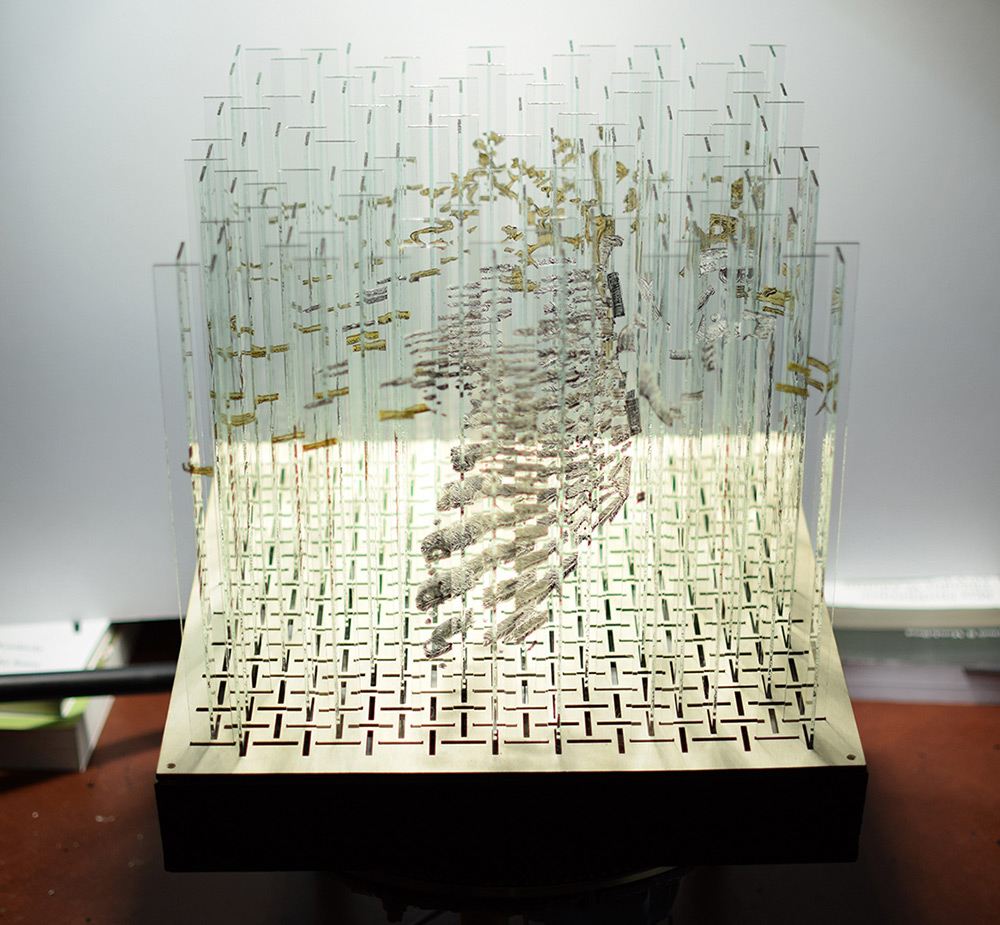 A Rotating Glass Sculpture Containing Four Hidden Anamorphic Paintings sculpture glass anamorphism