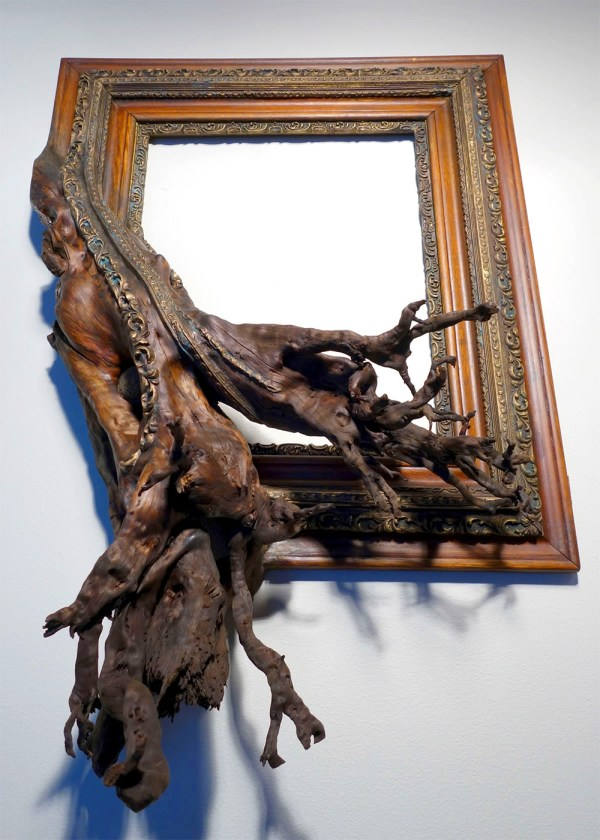 Twisted Tree Branches Fused With Ornate Frames
